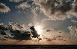 Sunset clouds and crepuscular rays over pacific edit.jpg