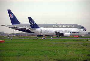 Flight planning - A Tarom Boeing 737–300 and United Airlines Boeing 777–200 taxiing to depart London Heathrow Airport.