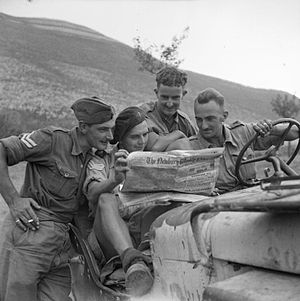 Newbury Weekly News - The British Army in Italy 1943: Men of the 2/6th Queen's Regiment read the Newbury Weekly News in their jeep, 29 September 1943.
