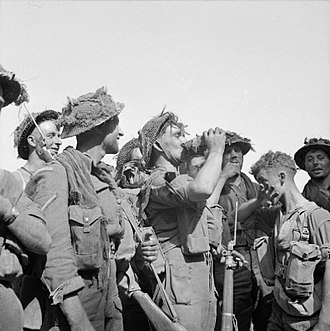 43rd (Wessex) Infantry Division - Sergeant Clifford Brown of the Somerset Light Infantry quenches his thirst with other members of his platoon during the attack on Mont Pincon, 7 August 1944.
