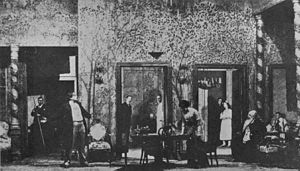 "Fourth wall - In Stanislavski's production of The Cherry Orchard (Moscow Art Theatre, 1904), a three-dimensional box set gives the illusion of a real room. The actors act as if unaware of the audience, separated by an invisible ""fourth wall"", defined by the Proscenium arch."