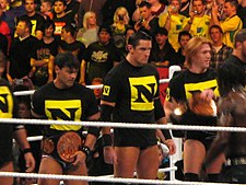 The Nexus as Tag Team Champions.jpg