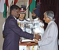 The President Dr. A.P.J. Abdul Kalam presenting the Dronacharya Award to the Hony. Captain M. Venu, VSM, in Boxing, for the year 2005 at a glittering function in New Delhi on August 29, 2006.jpg