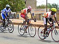 Three cyclists competing in Ouagadougou, Burkina Faso, 2009.jpg