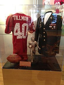 ed5192d0ac87 Tillman s Arizona Cardinals jersey on display alongside his military jacket  and other items at the NFL Experience during Super Bowl XLVI.