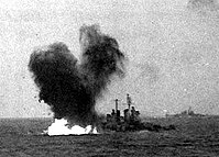 Torpedo hits USS Houston (CL-81), during the afternoon of 16 October 1944 (NH 98826)