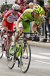 Alessandro De Marchi wearing a lime green cycling jersey.