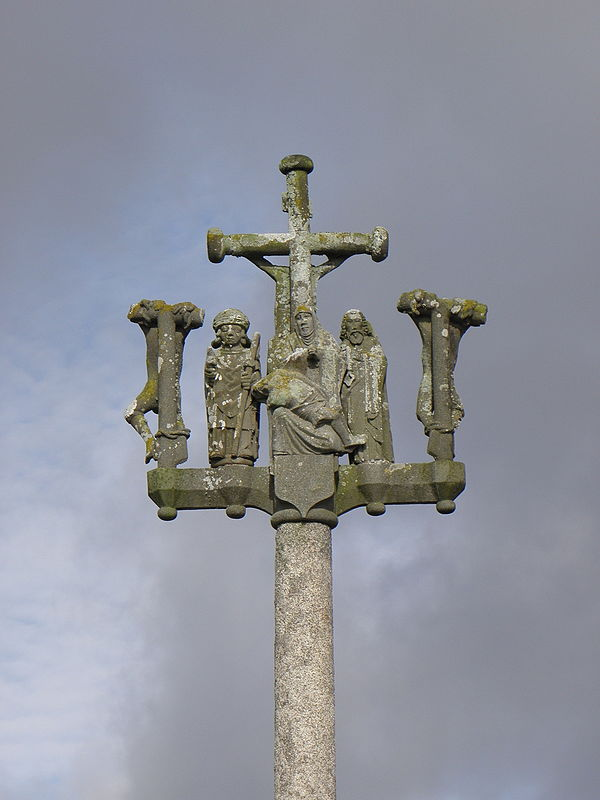 The calvary at Trézilidé. The Maître de Plougastel's depiction of a bishop can be seen on the left side of the pietà. John the Evangelist would be on the reverse side of this bishop