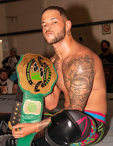 Professional wrestler Trey Miguel with the Alpha-1 Zero Gravity championship belt