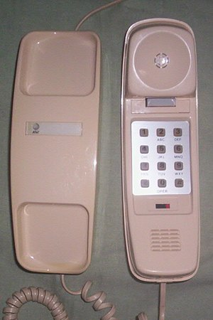 Trimline telephone - Redesigned touch-tone desk model Trimline, manufactured on January 9, 1985