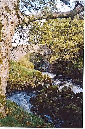 Tweedsmuir Bridge. The old stone bridge across...