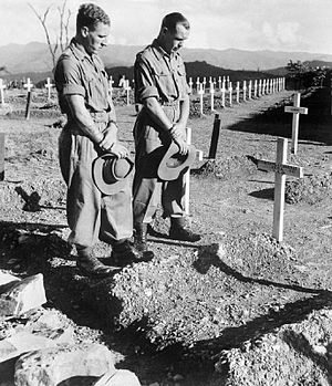 John Pennington Harman - Two soldiers visit the Military Cemetery at Kohima to pay their respects to their former comrade Lance Corporal John Harman VC, 1945