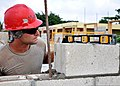 U.S. Air Force Staff Sgt. Matthew Morrison levels a concrete block at the construction site of the Louisiana Government Primary School in Belize on April 30, 2013 130430-F-FO324-004.jpg