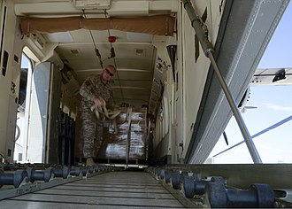 Short C-23 Sherpa - Unloading pallets of meals, ready to eat (MREs) from a C-23 Sherpa rear cargo door/ramp.