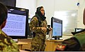 U.S. Army Cpl. Mariah Best, center, a public affairs specialist with the Regional Command South public affairs office, listens to a question from an Afghan National Army (ANA) soldier during a training exercise 131111-A-HP669-844.jpg