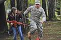 U.S. Army Pvt. Daniel Ovellette, right, assigned to the 230th Military Police Company, leads a girl through an obstacle course during the Month of the Military Child Fest at Pulaski Barracks, Germany, April 27 130427-F-YC884-276.jpg