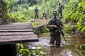 U.S. Army Soldier maneuvers through a river at the Jungle Warfare School during United Accord 2017 at Achiase military base, Akim Oda, Ghana, May 26, 2017.jpg