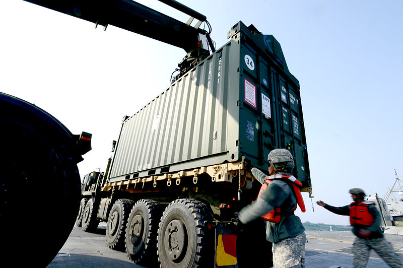 File:U.S. Army Spc. Tashaya Rodgers, left, and Sgt. Joseph White, both assigned to the 551st Inland Cargo Transportation Company, secure a container on a Palletized Loading System 1074 April 21, 2013, in Pohang 130421-N-LO372-182.jpg