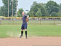 U.S. Coast Guard Petty Officer 3rd Class Christopher Yaw, a public affairs specialist with the 9th Coast Guard District External Affairs Office in Cleveland, throws to first base during his unit's softball 130731-G-KB946-002.jpg