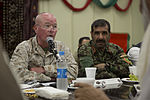 U.S. Marine Corps Maj. Gen. Walter L. Miller Jr., left, the commanding general of Regional Command (Southwest), speaks during a friendship dinner at the Afghan Cultural Center at Camp Leatherneck in Helmand 130725-M-RF397-265.jpg