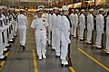U.S. Navy Capt. John T. Dye, center background, the commanding officer of Recruit Training Command, and Navy Chief of Information Rear Adm. John Kirby, center foreground, inspect a recruit honor guard unit 130524-N-BN978-002.jpg