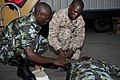 U.S. Navy Hospital Corpsman 3rd Class Paul McNair, right, inspects a tourniquet applied by a Kenyan sailor during a combat lifesaver course as part of Africa Partnership Station (APS) 2012 held aboard high-speed 120706-F-GA223-004.jpg