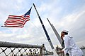 U.S. Navy Seaman Miguel Espinoza raises the national ensign aboard the guided missile destroyer USS Ross (DDG 71) in Constanta, Romania, Sept 140907-N-IY142-019.jpg