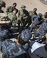 U.S. Sailors, top, assigned to Commander, Task Group 56 130611-N-BJ254-038.jpg
