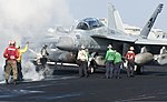 U.S. Sailors and Marines guide an EA-18G Growler aircraft assigned to Electronic Attack Squadron (VAQ) 130 onto a catapult on the flight deck of the aircraft carrier USS Harry S. Truman (CVN 75) March 8, 2014 140308-N-ZG705-028.jpg