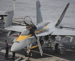U.S. Sailors perform checks on an F-A-18C Hornet aircraft assigned to Strike Fighter Squadron (VFA) 146 aboard the aircraft carrier USS Nimitz (CVN 68) June 15, 2013, in the Gulf of Oman 130615-N-KE148-034.jpg