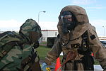 U. S. Marine Lance Cpl. Kenneth N. Dills, right, undergoes the decontamination process after carrying out the proper procedures for a mock chemical, biological, radiological and nuclear attack during CBRN 120831-M-GX379-337.jpg