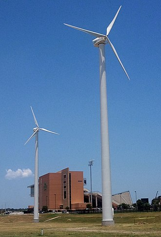 Apogee Stadium - Two of three university-owned turbines generating wind power for the stadium's electrical grid
