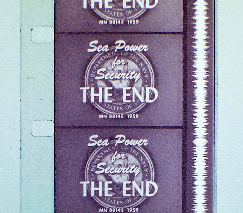"Vertical section of filmstrip, showing four-and-a-half frames, each of which reads, ""Sea Power for Security. The End."" Alongside the frames runs a continuous vertical white band of continuously fluctuating width."