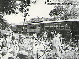 United States occupation of Nicaragua - The USS Denver ship's landing force under Lt. A. B. Reed rests beside the Corinto, Nicaragua railroad line, 1912.