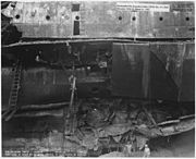 USS Oklahoma (BB37)- Salvage, 12-31-43, 7126-43, Port side at about fr 60 after removal of main patch in drydock - NARA - 296956