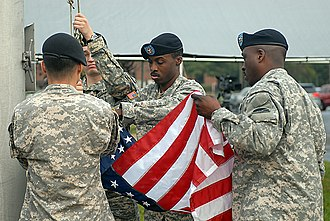 Camp Kilmer - A color guard from the 78th Division (Training) takes down the colors for the last time during the Kilmer U.S. Army Reserve Center's inactivation ceremony.