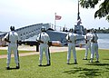 US Navy 030501-N-0106C-003 Sailors assigned to the Naval Station Pearl Harbor Firing Detail stand at parade rest near the submarine USS Bowfin (SS 287).jpg