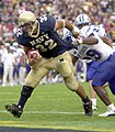 US Navy 031004-N-9693M-219 Navy fullback Kyle Eckel outpaces Air Force free safety Larry Duncan for a touchdown.jpg