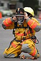 US Navy 031213-N-8937A-064 A fire fighter assigned to Commander U.S. Naval Forces Japan (CNFJ) Regional Fire Department dons protective equipment.jpg