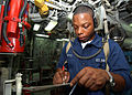 US Navy 040731-N-4374S-010 Fireman Apprentice Marquis Petty monitors the engine gauges in the main machinery room aboard the mine countermeasure ship USS Dextrous (MCM 13).jpg