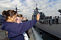 US Navy 041206-N-0685S-001 Family and friends wave goodbye as they watch the guided missile cruiser USS Bunker Hill (CG 52) departs Naval Base San Diego, Calif.jpg