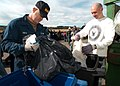 US Navy 050412-N-5134J-007 Volunteers from various commands onboard Naval Air Station Whidbey Island, Wash., participate in the base's Annual Dumpster Dive.jpg