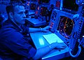 US Navy 050609-N-8604L-026 Operations Specialist 2nd Class Lucas Weaver of Three Rivers, Mich., mans the strike control console.jpg