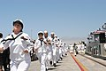 US Navy 050730-N-3672K-297 Sailors assigned to the Navy's newest Arleigh Burke-class destroyer, USS Halsey (DDG 96) run to man the ship as they bring the ship to life during the ship's commissioning ceremony.jpg