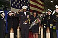US Navy 051121-N-2736O-003 Rear Adm. Ruebin B. Bookert, accompanied by his wife renders his final salute to honorary side boys during his change of command ceremony held aboard the amphibious assualt ship USS Saipan (LHA 2).jpg