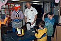 US Navy 060608-N-6247M-002 USS Ingraham (FFG 61), Commanding Officer Cmdr. Ricks W. Polk and Brenda Johnson (Raggedy Ann) give ship covers to school children during a tour of the ship.jpg