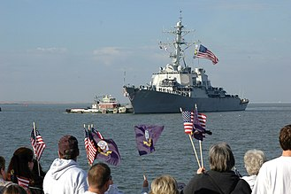 Battle ensign - USS McFaul flying her battle ensign as she returns to Naval Station Norfolk, Virginia from deployment.
