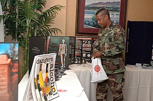 Substance abuse prevention - US Navy Master-at-Arms 1st Class Michael Turner of Mobile Security Squadron Two (MSS-2) collects information at the Substance Abuse Prevention Summit