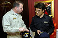 US Navy 070316-N-1635S-001 After exchanging gifts on board USS Ronald Reagan (CVN 76), Commanding Officer Capt. Terry B. Kraft gives his personal coin to Capt. Fumio Suetsugu, Commander Escort Division (CCD) 63.jpg