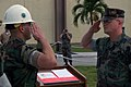 US Navy 071012-N-7367K-023 Lt. Cmdr. Michael Mihaly, left, the Guam detachment officer-in-charge for U.S. Naval Mobile Construction Battalion (NMCB) 1, accepts command over Camp Covington from Lt. Cmdr. Kemit Spears, the execut.jpg